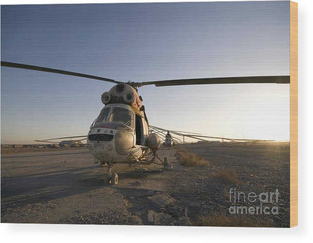 Aviation Wood Print featuring the photograph An Iraqi Helicopter Sits On The Flight by Terry Moore