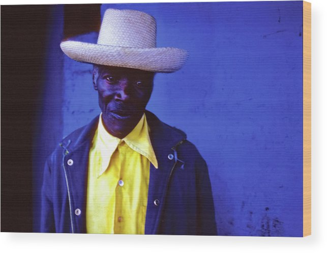 Haiti Wood Print featuring the photograph Blue Man With Yellow Hat And Shirt by Johnny Sandaire