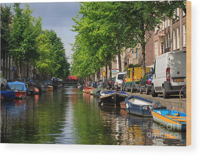 Boats Wood Print featuring the photograph Canal Scene In Amsterdam by Louise Heusinkveld
