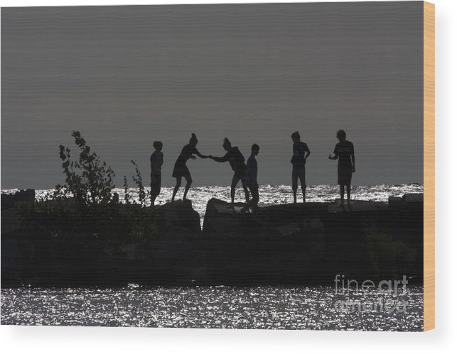 People Wood Print featuring the photograph People Walking On Rocks By The Water by Christopher Purcell