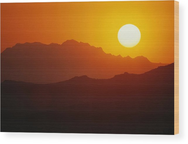 united States Wood Print featuring the photograph Sunset Over Silhouetted Mountain Ridges by Raymond Gehman