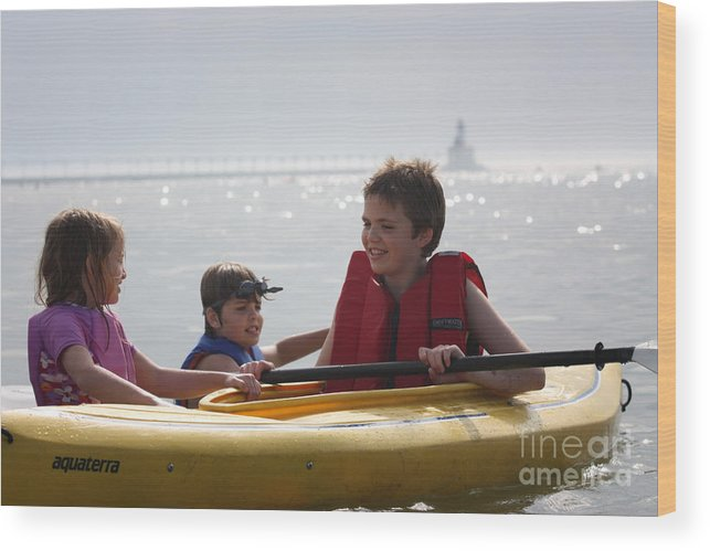 Horizontal Wood Print featuring the photograph Young Kids Playing On A Kayak by Christopher Purcell