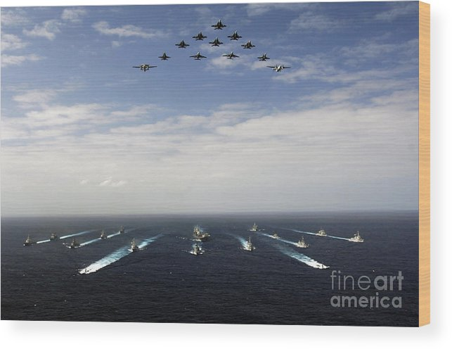 Horizontal Wood Print featuring the photograph Aircraft Fly Over A Group Of U.s by Stocktrek Images