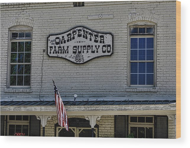 Historic Carpenter Farm Supply Wood Print featuring the photograph Carpenter Farm Supply Co Sign by Selena Wagner