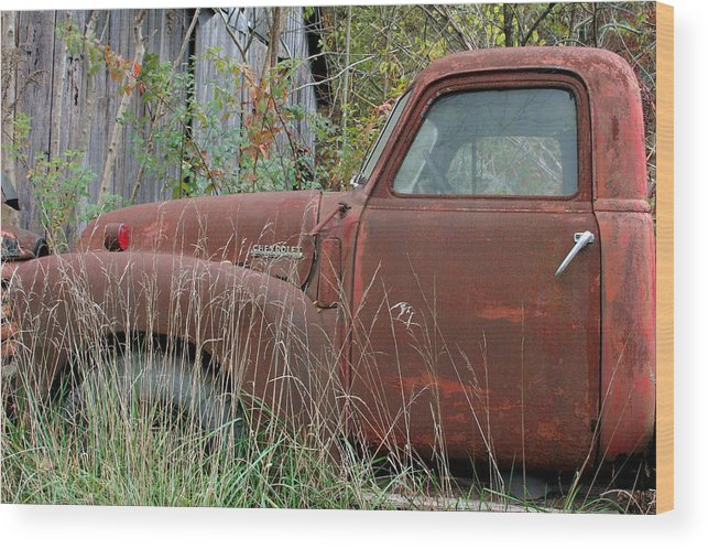 Rustic Fine Art Wood Print featuring the photograph Chevy Truck Rusting Along Road by George Ferrell