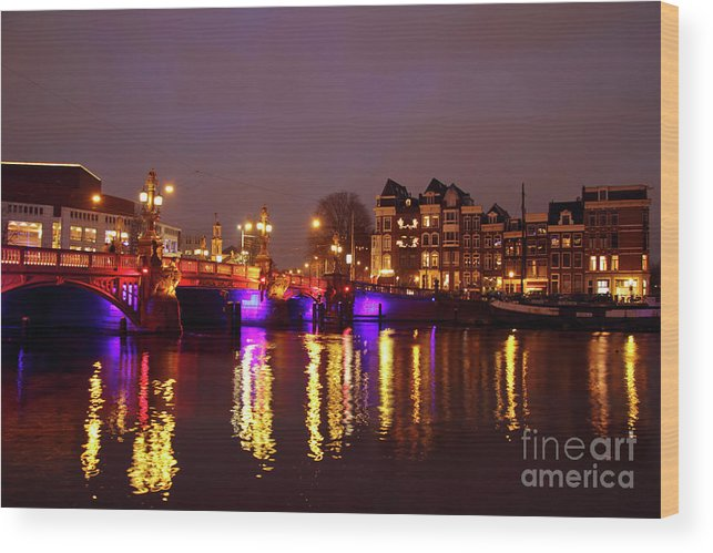 Amstel Wood Print featuring the photograph City Scenic From Amsterdam With The Blue Bridge In The Netherlands by Nisangha Ji