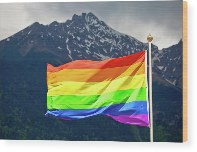 Gay Wood Print featuring the photograph Lgbtq Rainbow Flag With Snowy Mountain Background View by Brch Photography