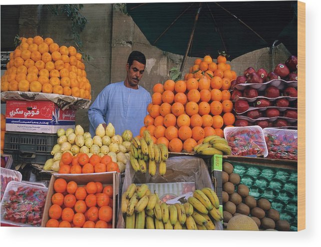Abundance Wood Print featuring the photograph Market Vendor Selling Fruit In A Bazaar by Sami Sarkis