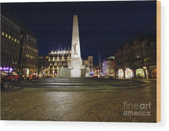 Amsterdam Wood Print featuring the photograph Monument On The Dam In Amsterdam Netherlands At Night by Nisangha Ji
