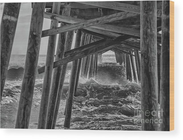 Black And White Wood Print featuring the photograph Pier Storm by Kelley Freel-Ebner
