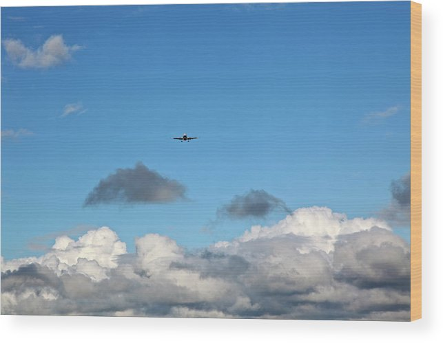 Plane: Through The Clouds Wood Print featuring the photograph Plane Coming Into Land by Ann O Connell