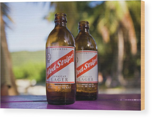 Beef Island Wood Print featuring the photograph Redstripe by Diego Pagani