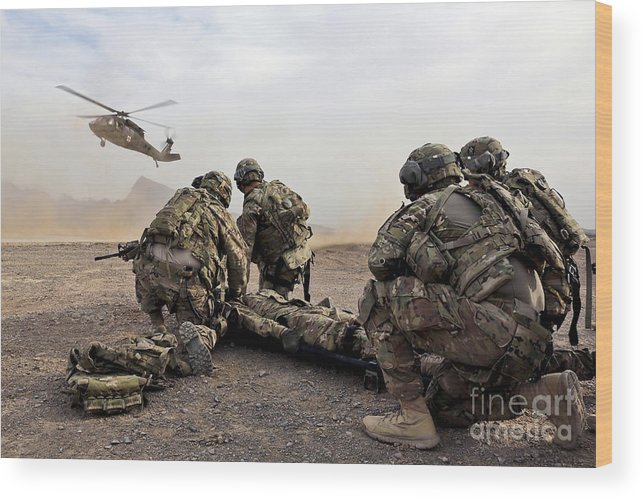 Afghanistan Wood Print featuring the photograph Security Force Team Members Wait by Stocktrek Images