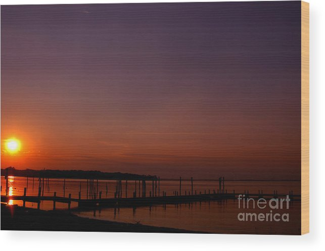 Clay Wood Print featuring the photograph The Sun Sets Over The Water by Clayton Bruster