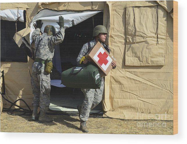 Us Air Force Wood Print featuring the photograph U.s. Air Force Soldier Exits A Medical by Stocktrek Images
