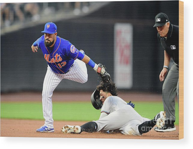 American League Baseball Wood Print featuring the photograph Miami Marlins V New York Mets - Game Two by Steven Ryan