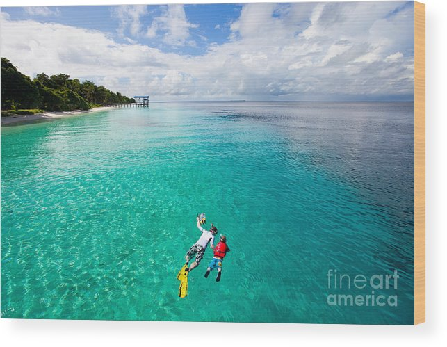 Activity Wood Print featuring the photograph Father And Son Snorkeling In A Tropical by Blueorange Studio