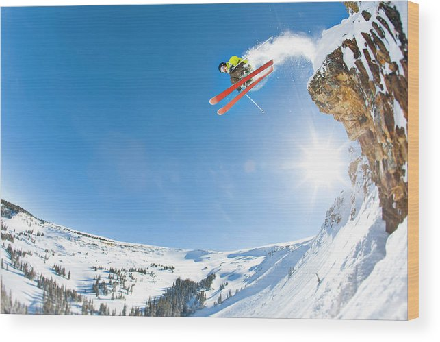Scenics Wood Print featuring the photograph Freestyle Skier Jumping Off Cliff by Tyler Stableford