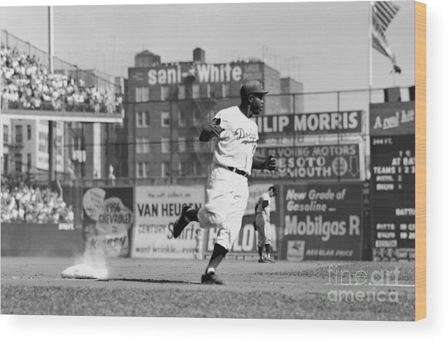 1950-1959 Wood Print featuring the photograph Jackie Robinson Rounds The Bases by Robert Riger