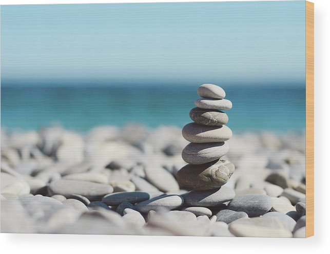 French Riviera Wood Print featuring the photograph Pile Of Stones On Beach by Dhmig Photography