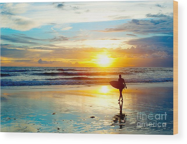 Southern Wood Print featuring the photograph Surfer On The Ocean Beach At Sunset On by Joyfull