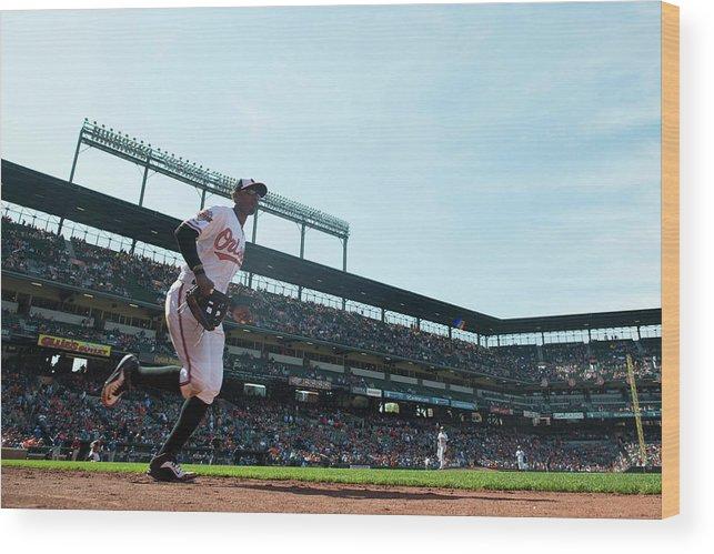 American League Baseball Wood Print featuring the photograph Adam Jones by Rob Tringali