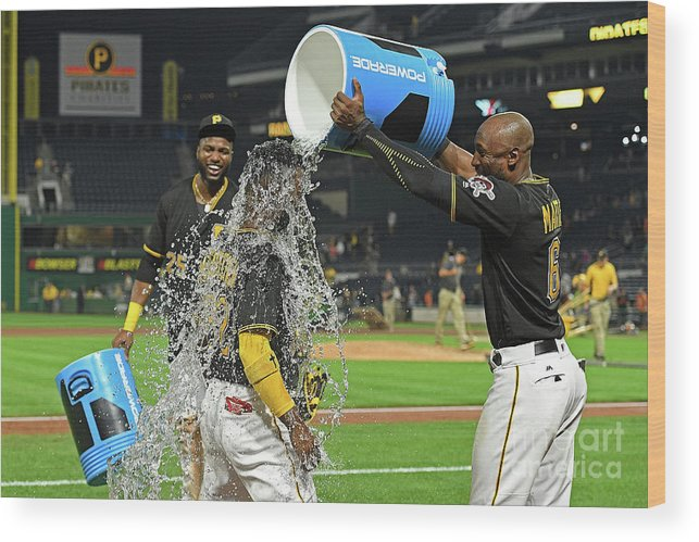 Three Quarter Length Wood Print featuring the photograph Andrew Mccutchen, Starling Marte, And Gregory Polanco by Justin Berl