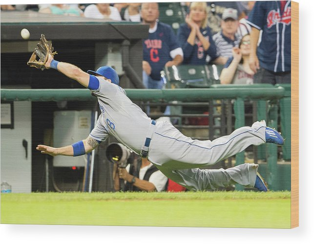 American League Baseball Wood Print featuring the photograph Mike Moustakas And Lonnie Chisenhall by Jason Miller