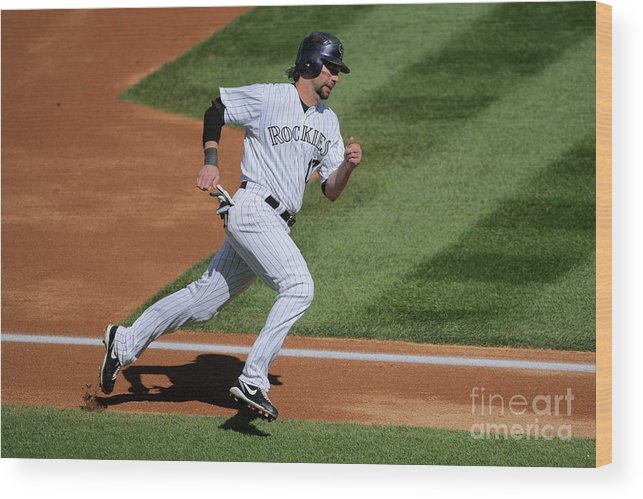 Scoring Wood Print featuring the photograph Todd Helton, Manny Parra, And Garrett Atkins by Doug Pensinger
