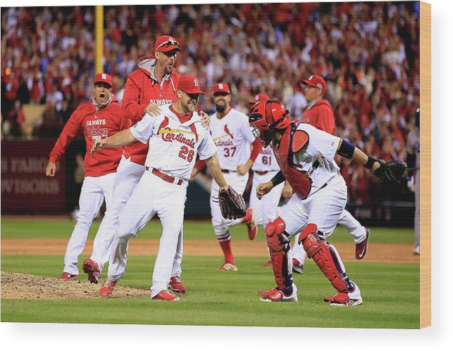 St. Louis Cardinals Wood Print featuring the photograph Yadier Molina And Trevor Rosenthal by Jamie Squire