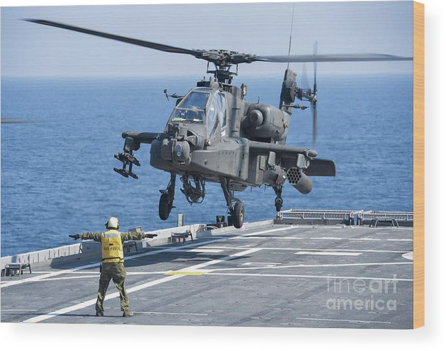 Military Wood Print featuring the photograph An Army Ah-64d Apache Helicopter by Stocktrek Images
