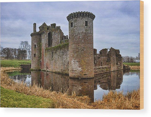 Landscape Wood Print featuring the photograph Caerlaverock Castle by Jean-Noel Nicolas