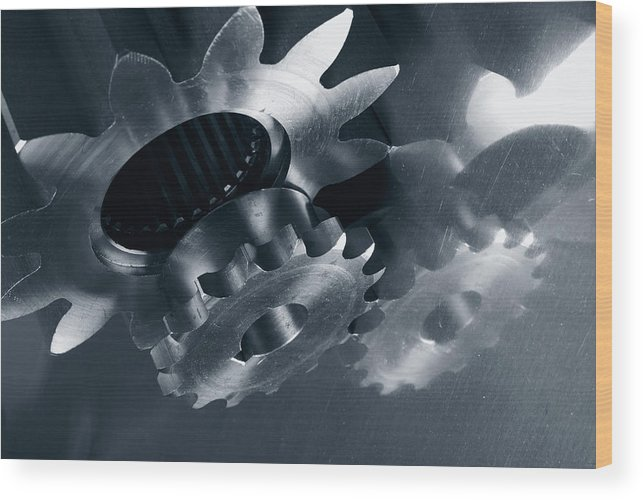 Gears Wood Print featuring the photograph Gears And Cogs Mirrored In Titanium by Christian Lagereek
