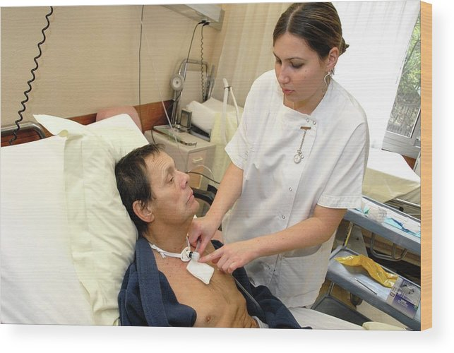 Equipment Wood Print featuring the photograph Nurse Replacing Tracheostomy Tube by Aj Photo/science Photo Library