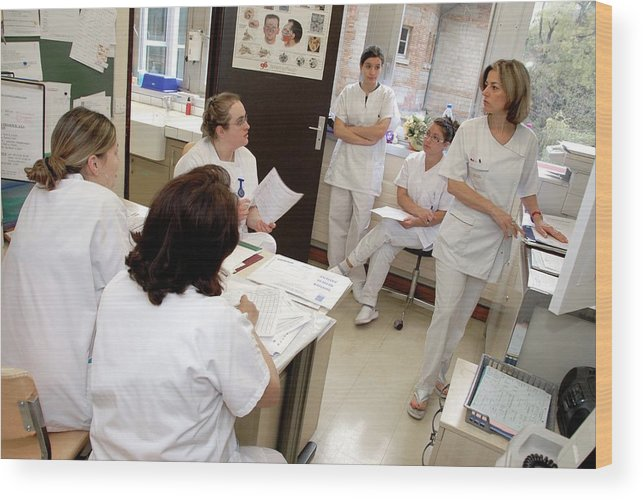 Human Wood Print featuring the photograph Nurse Workstation Meeting by Aj Photo/science Photo Library