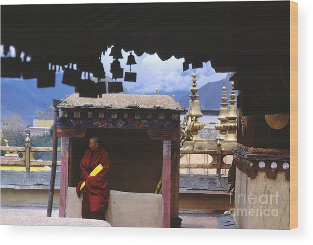 Tibet Wood Print featuring the photograph Tibetan Monk With Scroll On Jokhang Roof by Anna Lisa Yoder