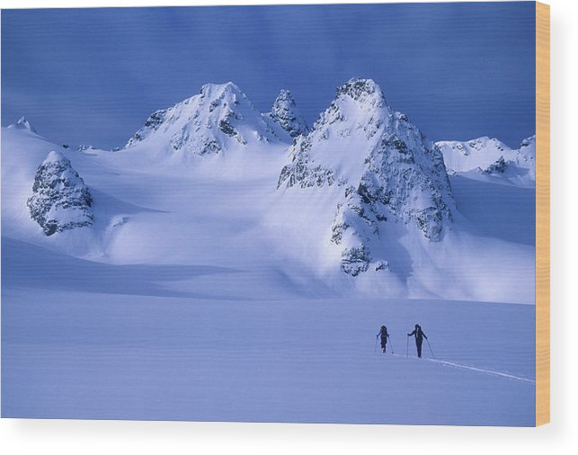 Adventure Wood Print featuring the photograph Two Skiers Ski Tour And Explore by Jimmy Chin