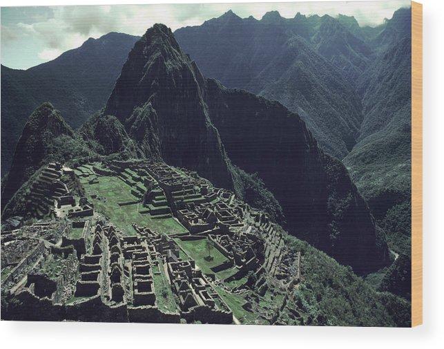 Machu Picchu Wood Print featuring the photograph Machu Picchu, A Pre-columian Inca Ruin by Ira Block