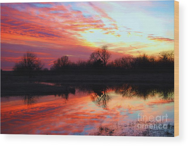 Clouds Wood Print featuring the photograph Calming Sunset by Larry Keahey