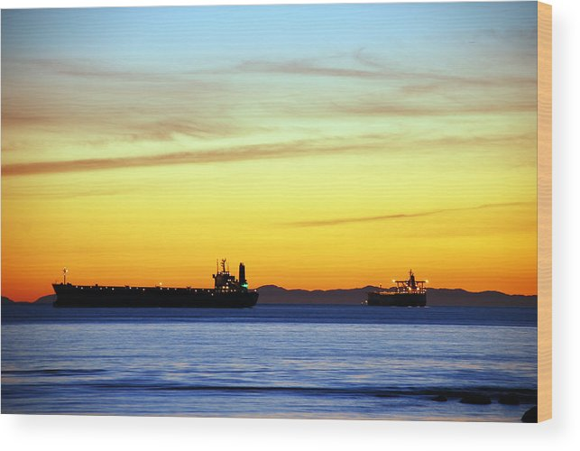 Cargo Wood Print featuring the photograph Cargo Ships At Sunset by Alasdair Turner