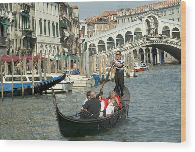 Venice Wood Print featuring the photograph Gonfolas On Venice Canal At Rialto Bridge by Charles Ridgway