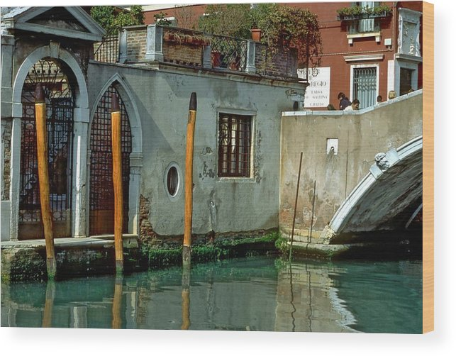 Venice Wood Print featuring the photograph Poles On Canal In Venice by Michael Henderson