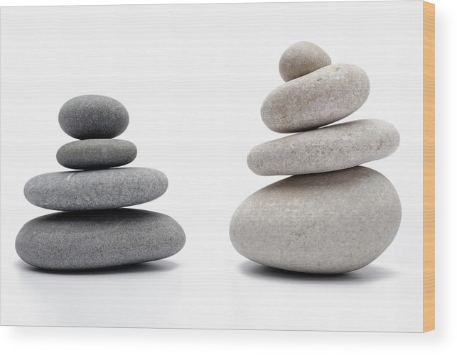 Order Wood Print featuring the photograph Two Stacks Of White And Gray Pebbles by Sami Sarkis