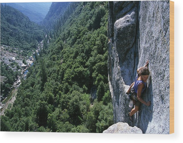 People Wood Print featuring the photograph Woman Rock Climbing High Above River by Heath Korvola