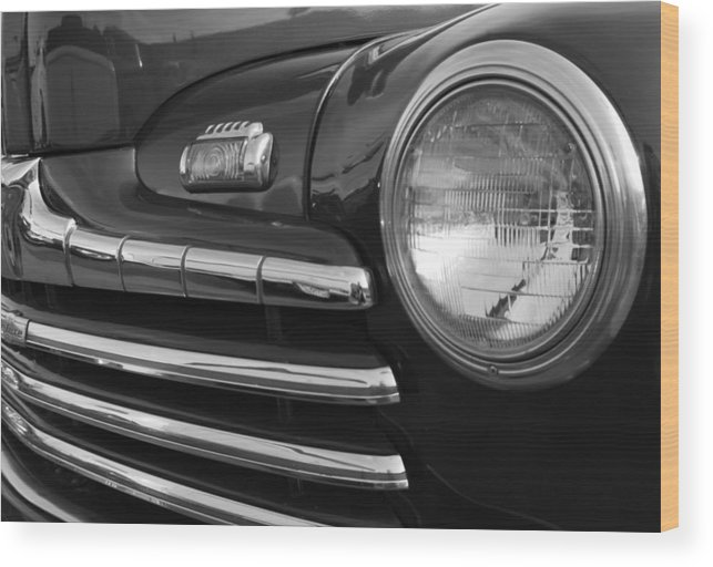 1946 Ford Deluxe Wood Print featuring the photograph 1946 Ford Deluxe 2 Door Sedan Head Light by DJ Monteleone