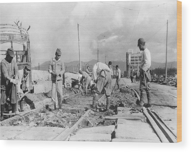 History Wood Print featuring the photograph Japanese Soldiers Repair Street Car by Everett
