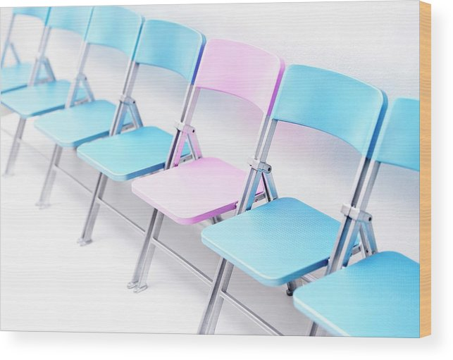 Chair Wood Print featuring the photograph One Pink Chair In A Row Of Blue Chairs by Cordelia Molloy/science Photo Library