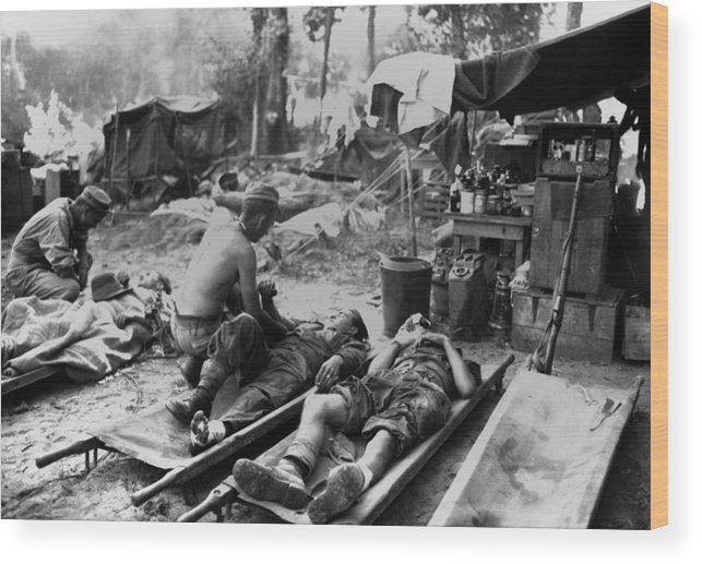 History Wood Print featuring the photograph U.s. Army Medics Treat Wounded Soldiers by Everett