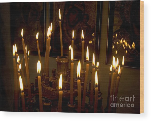 Lit Wood Print featuring the photograph lit Candles in church by Danny Yanai