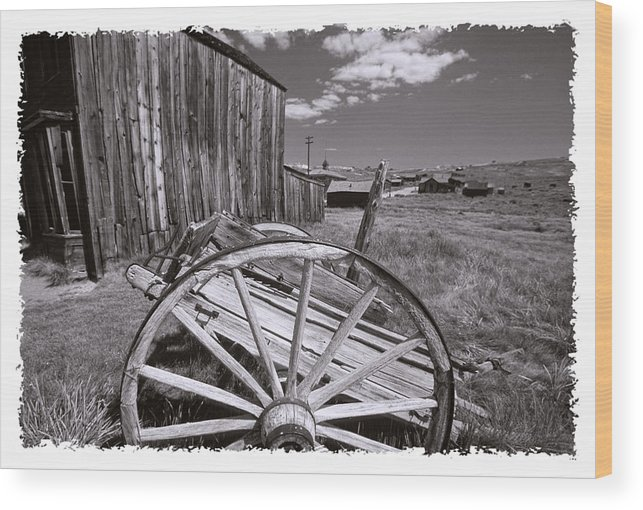 Black And White Wood Print featuring the photograph Old Cart And Building Bodie California by George Oze